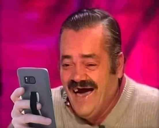 Risitas missing teeth man looking at phone laughing meme