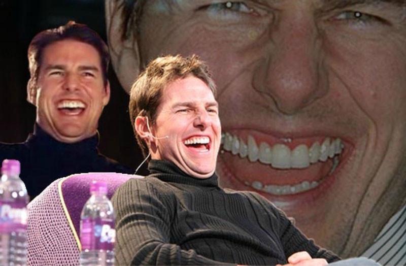 Laughing Tom Cruise sitting meme
