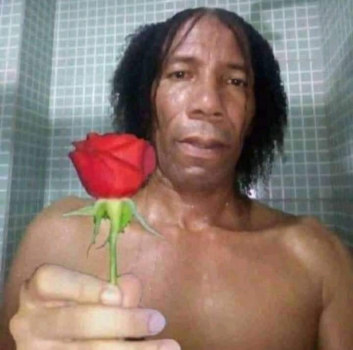 Black guy giving a rose flower meme