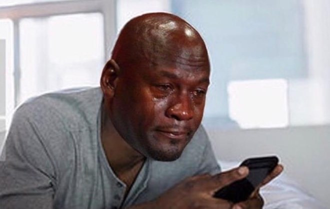 Michael Jordan crying looking at phone meme