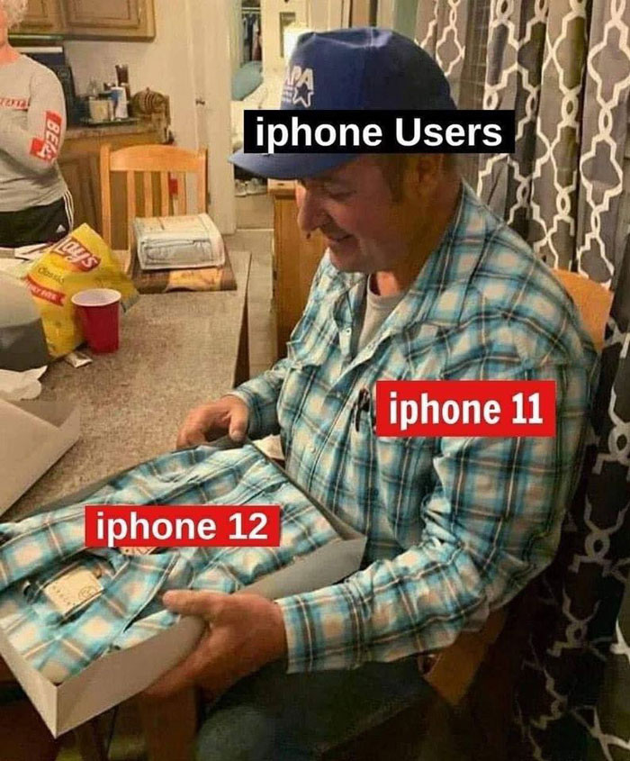 iPhone users unboxing iPhone 12 meme - wearing a shirt unboxing the same shirt