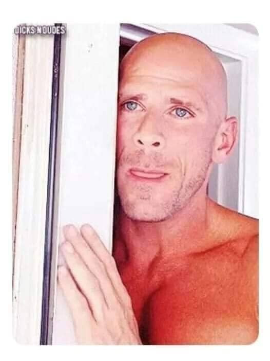 Johnny Sins standing by the door licking his lips meme